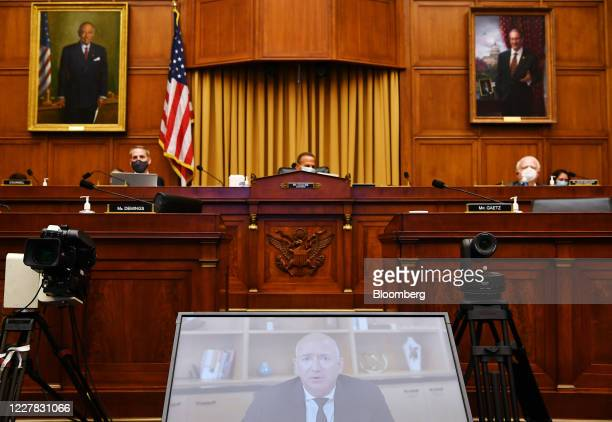 Jeff Bezos, founder and chief executive officer of Amazon.com Inc., speaks via videoconference during a House Judiciary Subcommittee hearing in...