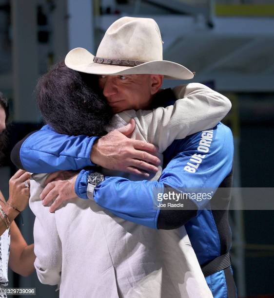 Jeff Bezos hugs his mother, Jacklyn Bezos, after his flight on Blue Origin's New Shepard into space during a press conference on July 20, 2021 in Van...