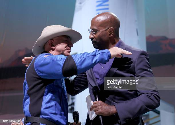 Jeff Bezos hugs Van Jones, founder of Dream Corps, after announcing a $100 million award for his projects that help humanity on July 20, 2021 in Van...