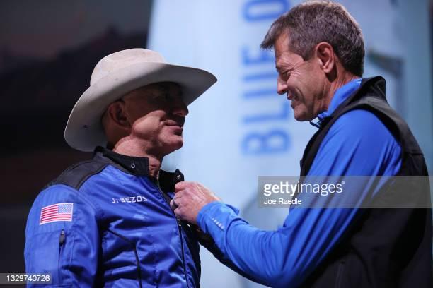 Jeff Bezos receives astronaut wings from Blue Origin's Jeff Ashby, a former Space Shuttle commander, after her flight on Blue Origin's New Shepard...
