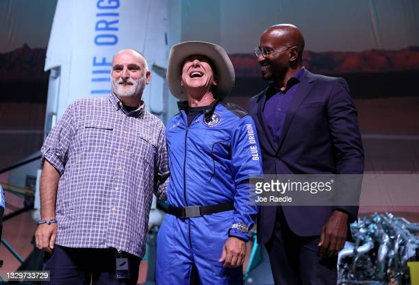Jeff Bezos stands with Chef Jose Andres and Van Jones, founder of Dream Corps, after announcing a $100 million award for their projects that help...