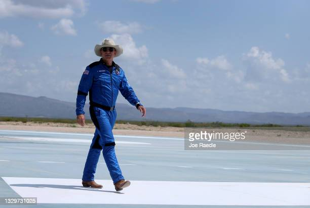 Jeff Bezos walks near Blue Origin's New Shepard after flying into space on July 20, 2021 in Van Horn, Texas. Mr. Bezos and the crew that flew with...