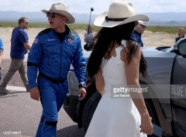 Jeff Bezos walks near the booster after his flight on Blue Origin's New Shepard into space on July 20, 2021 in Van Horn, Texas. Mr. Bezos and the...
