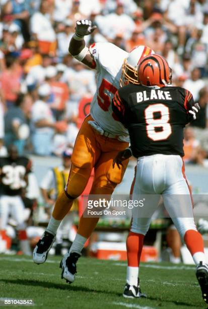 Jeff Blake of the Cincinnati Bengals get his pass off under pressure from Hardy Nickerson of the Tampa Bay Buccaneers during an NFL football game...