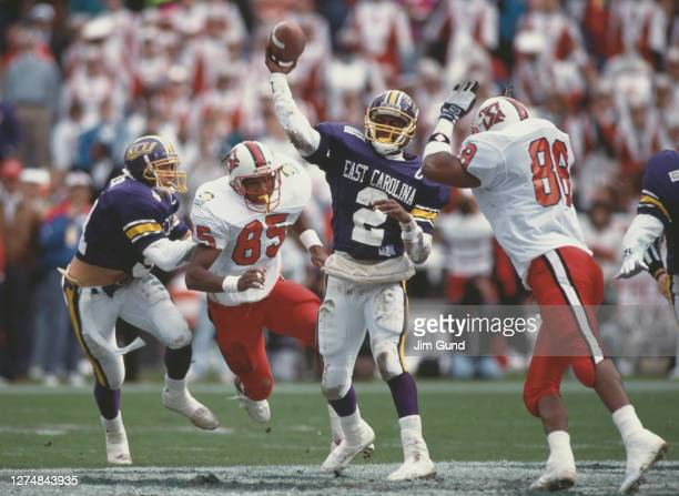 Jeff Blake, Quarterback for the East Carolina Pirates throws the ball downfield during the 1991 NCAA Division I-A Peach Bowl college football game...