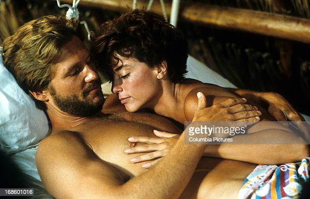 Jeff Bridges and Rachel Ward affectionate with one an other in bed in a scene from the film 'Against All Odds' 1984