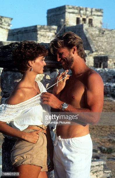 Jeff Bridges and Rachel Ward standing face to face while flirting with one an other in a scene from the film 'Against All Odds' 1984