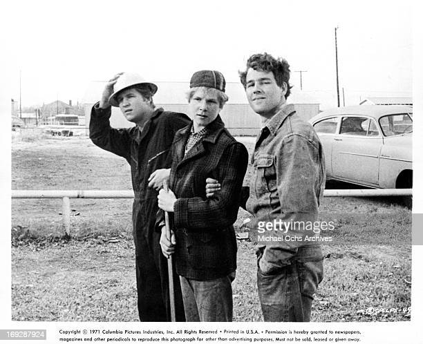 Jeff Bridges and Timothy Bottoms taking care of retarded boy Sam Bottoms in a scene from the film 'The Last Picture Show' 1971