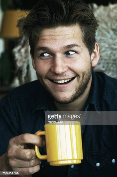 Jeff Bridges holding a yellow mug at his home in Malibu