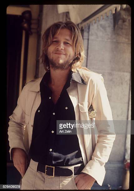 Jeff Bridges in a black shirt and tan jacket circa 1970 New York