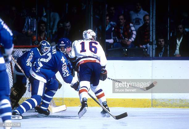 Jeff Brown of the Quebec Nordiques battles for position with Pat LaFontaine of the New York Islanders on April 2 1987 at the Nassau Coliseum in...