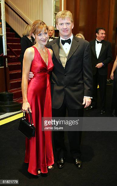 Jeff Burton and his date arrive for the 2004 NASCAR Nextel Cup Awards at the Waldorf Astoria on December 3 2004 in New York City