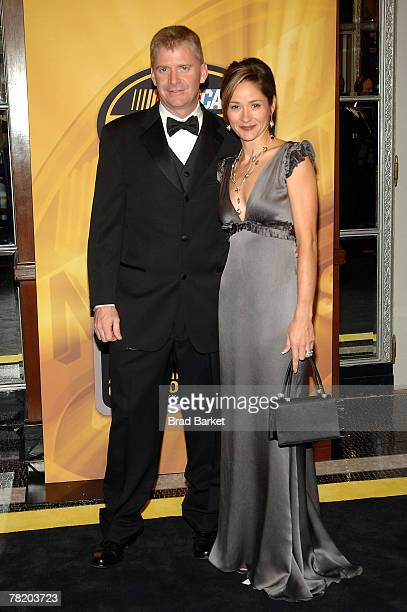 Jeff Burton driver of the ATT Mobility Chevrolet and his wife Kim arrive at the NASCAR Nextel Cup Series Awards Ceremony at The Waldorf Astoria on...