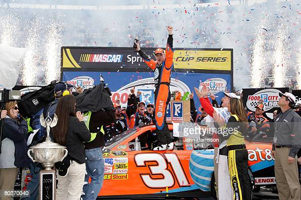 Jeff Burton driver of the ATT Mobility Chevrolet celebrates in victory lane after winning the NASCAR Sprint Cup Series Food City 500 at the Bristol...