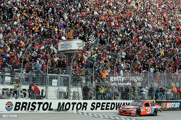 Jeff Burton driver of the ATT Mobility Chevrolet crosses the finish line to win the NASCAR Sprint Cup Series Food City 500 at the Bristol Motor...