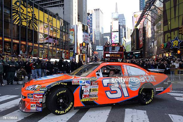Jeff Burton, driver of the AT&T Mobility Chevrolet, drives down Times Square in a victory lap through the streets of Midtown during NASCAR Champions...