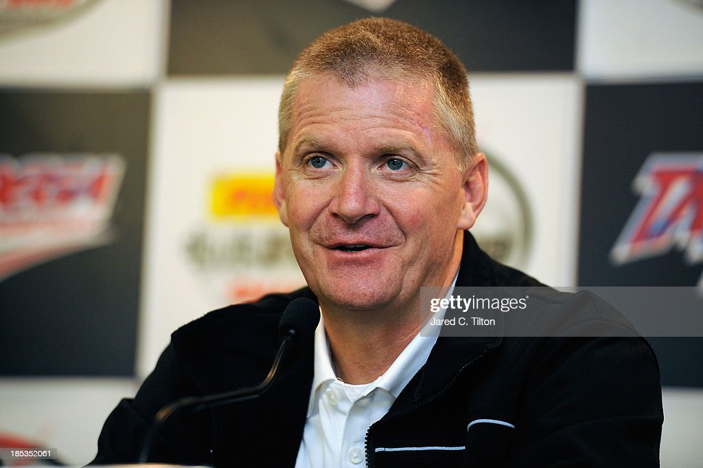 Jeff Burton, driver of the #31 Caterpillar Chevrolet, speaks during a press conference during qualifying for the NASCAR Sprint Cup Series 45th Annual Camping World RV Sales 500 at Talladega Superspeedway on October 19, 2013 in Talladega, Alabama.
