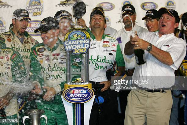 Jeff Burton driver of the Holiday Inn Chevrolet and owner Richard Childress celebrate in victory lane after winning the NASCAR Busch Series Camping...