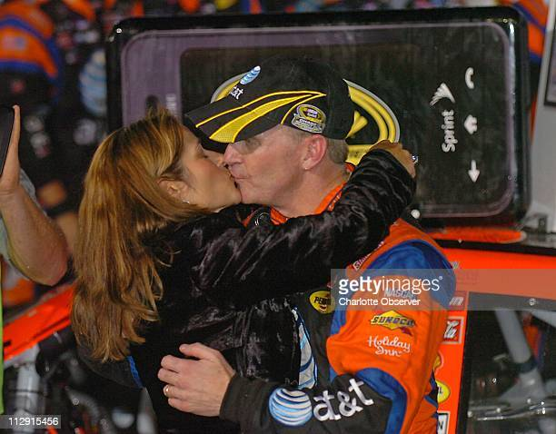 Jeff Burton get a kiss from wife Kim in victory lane after winning the Bank of America 500 NASCAR Sprint Series race on Saturday October 11 at Lowe's...