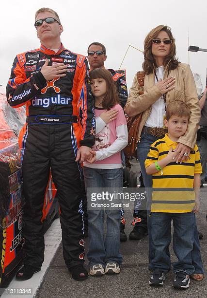 Jeff Burton left his daughter Paige son Harrison and wife Kim top right stand while the national anthem plays before the Gatorade Duel 150's at the...