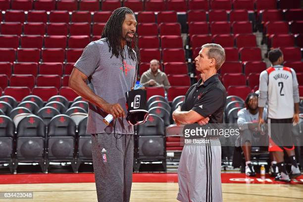 Jeff Bzdelik and Nene Hilario of the Houston Rockets talk during an all access practice on February 2 2017 at the Toyota Center in Houston Texas NOTE...