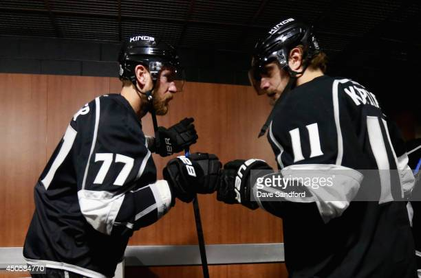 Jeff Carter and Anze Kopitar of the Los Angeles Kings bump fists before taking on the New York Rangers in Game Five of the 2014 Stanley Cup Final at...