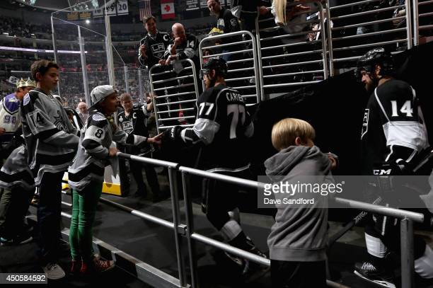 Jeff Carter and Justin Williams of the Los Angeles Kings walk to the ice to play in the third period of Game Five of the 2014 Stanley Cup Final...