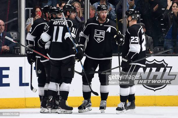 Jeff Carter Anze Kopitar and Dustin Brown of the Los Angeles Kings celebrate Carter's second period goal during the game against the Arizona Coyotes...