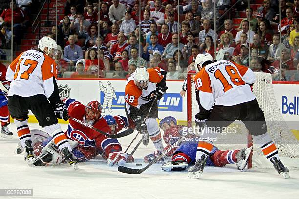 Jeff Carter Danny Briere and Mike Richards of the Philadelphia Flyers fight for the puck loose pucking in front of the goal against Hal Gill and...