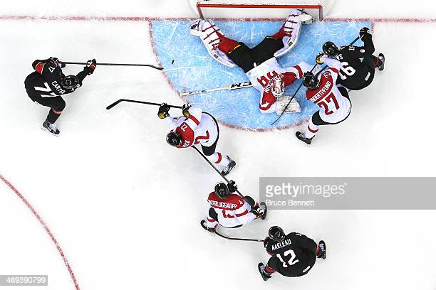 Jeff Carter of Canada scores a goal in the second period against Bernhard Starkbaum of Austria during the Men's Ice Hockey Preliminary Round Group B...