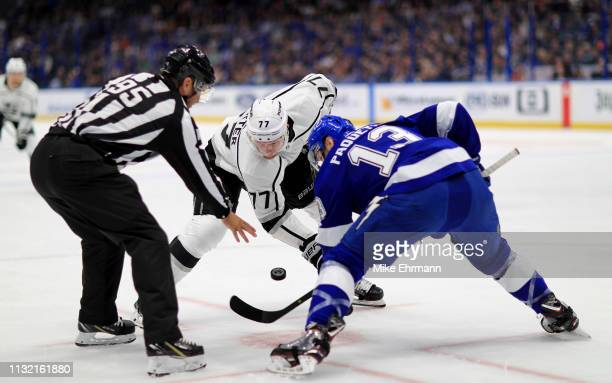 Jeff Carter of the Los Angeles Kings and Cedric Paquette of the Tampa Bay Lightning face off during a game at Amalie Arena on February 25 2019 in...