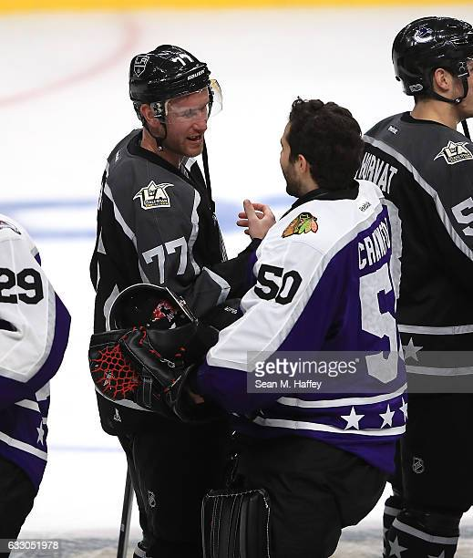 Jeff Carter of the Los Angeles Kings and Corey Crawford of the Chicago Blackhawks shake hands after the 2017 Honda NHL AllStar Game Semifinal at...