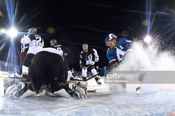 Jeff Carter of the Los Angeles Kings and Erik Johnson of the Colorado Avalanche skate to the puck during the first period of the 2020 NHL Stadium...