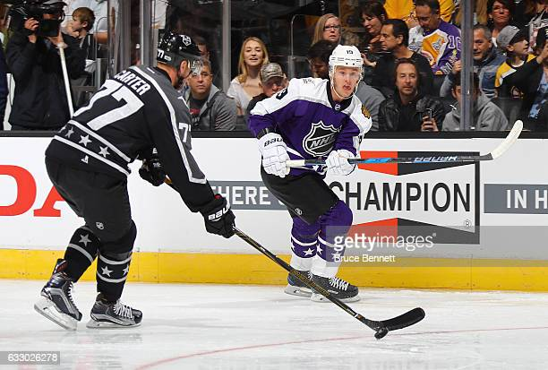 Jeff Carter of the Los Angeles Kings and Jonathan Toews of the Chicago Blackhawks battle for the puck during the 2017 Honda NHL AllStar Game...