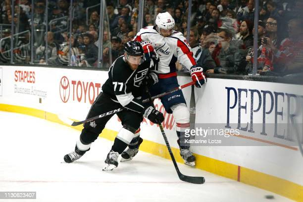 Jeff Carter of the Los Angeles Kings and Nic Dowd of the Washington Capitals fight for control of the puck during the second period at Staples Center...