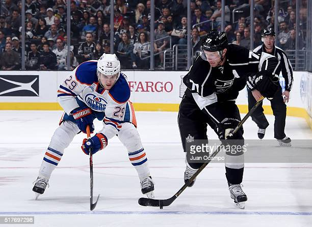 Jeff Carter of the Los Angeles Kings battles for the puck against Leon Draisaitl of the Edmonton Oilers on March 26 2016 at STAPLES Center in Los...