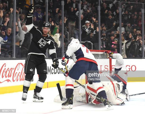 Jeff Carter of the Los Angeles Kings celebrates his goal behind TJ Oshie and Philipp Grubauer of the Washington Capitals to take a 10 lead during the...
