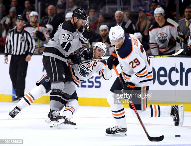 Jeff Carter of the Los Angeles Kings checks Connor McDavid of the Edmonton Oilers to the ice during the third period in a 4-0 Kings win at Staples...