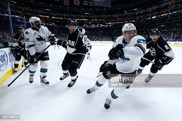 Jeff Carter of the Los Angeles Kings Joel Ward of the San Jose Sharks Jeff Schultz of the Los Angeles Kings Tommy Wingels of the San Jose Sharks and...