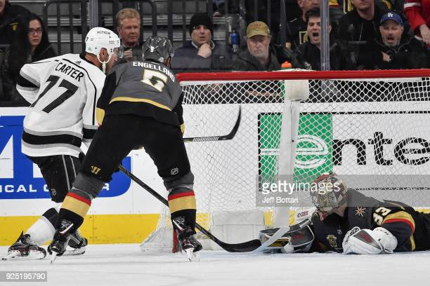 Jeff Carter of the Los Angeles Kings scores a goal against Deryk Engelland and goalie Maxime Lagace of the Vegas Golden Knights during the game at...