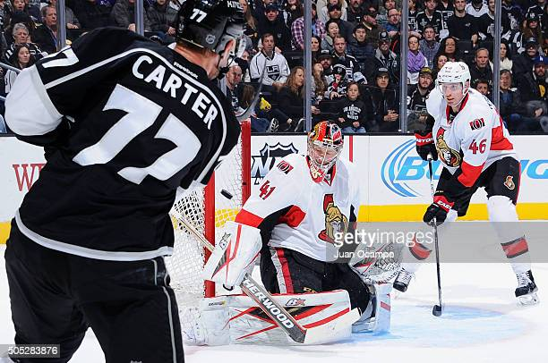 Jeff Carter of the Los Angeles Kings scores against Craig Anderson and Patrick Wiercioch of the Ottawa Senators on January 16 2016 at Staples Center...
