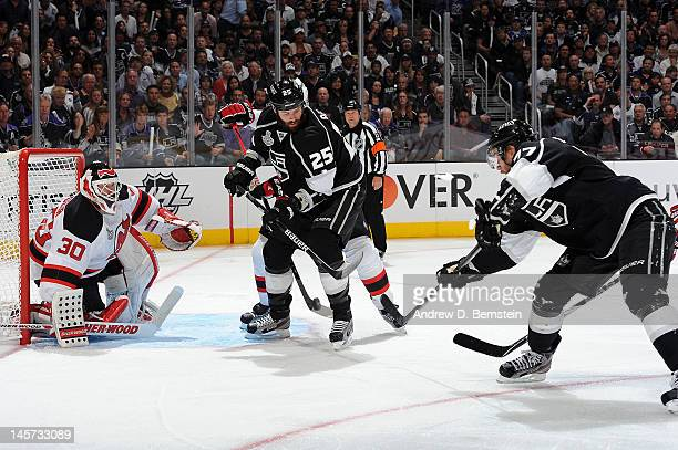 Jeff Carter of the Los Angeles Kings shoots and scores a goal against Martin Brodeur of the New Jersey Devils in Game Three of the 2012 Stanley Cup...