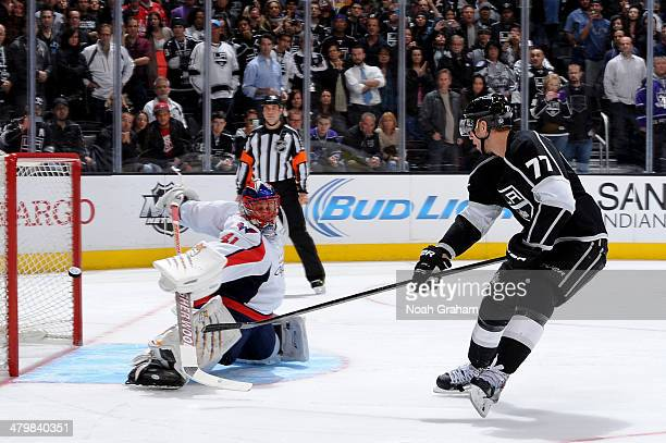 Jeff Carter of the Los Angeles Kings shoots and scores during the shootout against Jaroslav Halak of the Washington Capitals at Staples Center on...