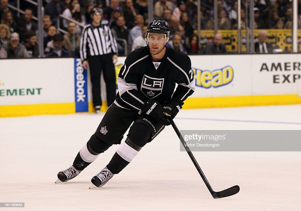 Jeff Carter #77 of the Los Angeles Kings skates on the forecheck during the NHL game against the Columbus Blue Jackets at Staples Center on February 15, 2013 in Los Angeles, California. The Kings defeated the Blue Jackets 2-1.