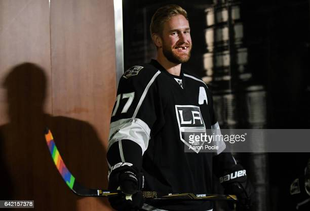 Jeff Carter of the Los Angeles Kings smiles as he sports rainbow stick tape in honor of Pride Night prior to the game against the Arizona Coyotes on...