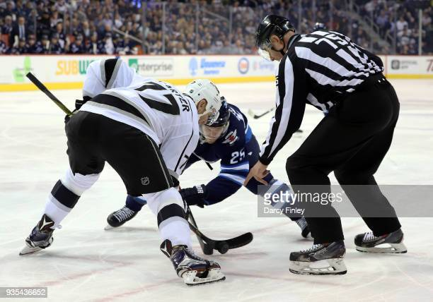 Jeff Carter of the Los Angeles Kings takes a first period faceoff against Paul Stastny of the Winnipeg Jets at the Bell MTS Place on March 20 2018 in...