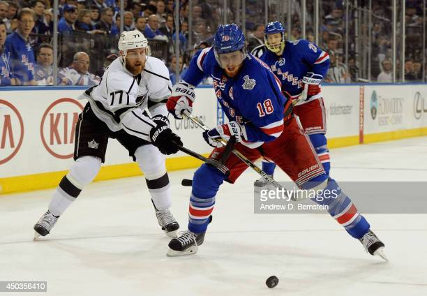 Jeff Carter of the Los Angeles Kings tries to stop Marc Staal of the New York Rangers in the first period of Game Three of the 2014 Stanley Cup Final...
