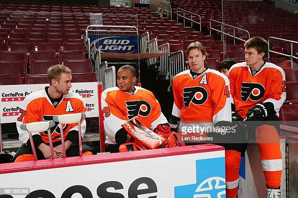 Jeff Carter Ray Emery Kimmo Timonen and James van Riemsdyk of the Philadelphia Flyers prepare for the annual team photo on March 29 2010 at the...