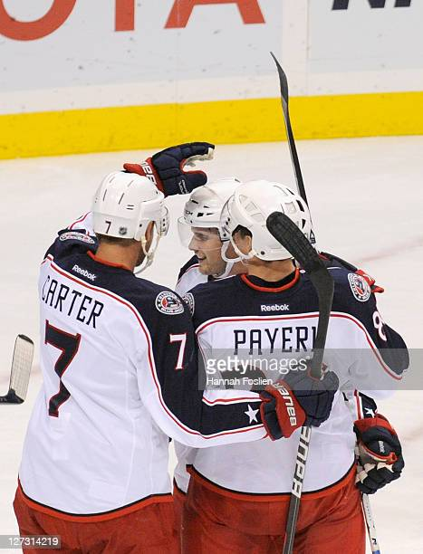 Jeff Carter Ryan Russell and Adam Payerl of the Columbus Blue Jackets celebrate a goal against the Minnesota Wild on September 23 2011 at Xcel Energy...