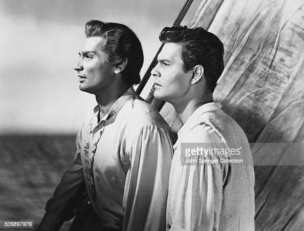 Jeff Chandler as Tenga, and Louis Jourdan as Andre Laurence in the 1951 film Bird of Paradise.